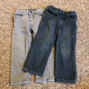 set of grey jeans and blue jeans